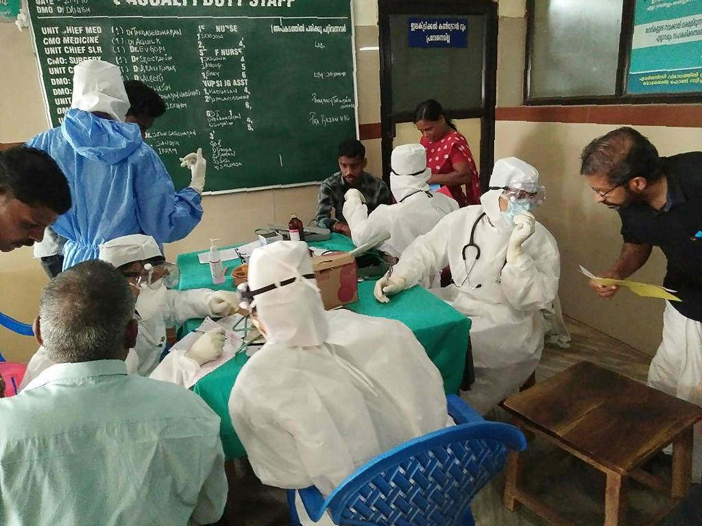 Medical personnel wearing protective suits check patients at the Medical College hospital in Kozhikode after a deadly virus carried mainly by fruit bats killed at least 10 people in southern India. Picture: AFP