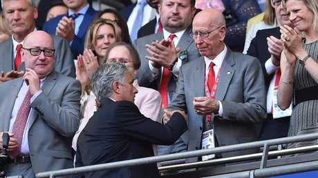 Manchester United manager Jose Mourinho shakes hands with Manchester United and England legend Bobby Charlton after losing the FA Cup final .