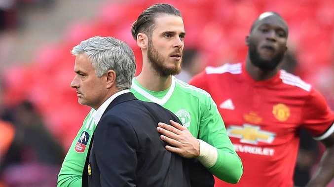 Jose Mourinho reacts with Manchester United goalkeeper David de Gea after losing the English FA Cup final to Chelsea.