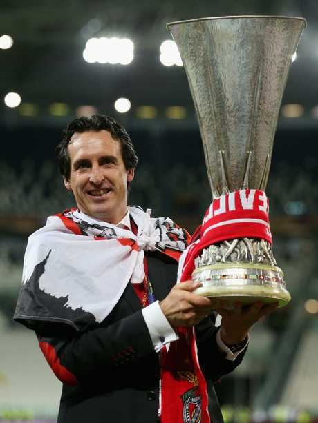 Unai Emery poses with the Europa League trophy.