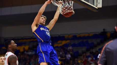 Tom Fullarton dunks in a game for Brisbane.