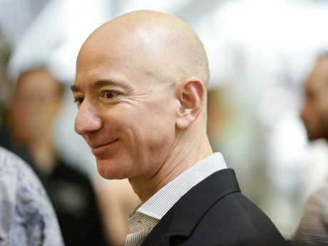 Chief Executive Officer of Amazon, Jeff Bezos, tours the facility at the grand opening of the Amazon Spheres, in Seattle, Washington. Picture: Jason Redmond