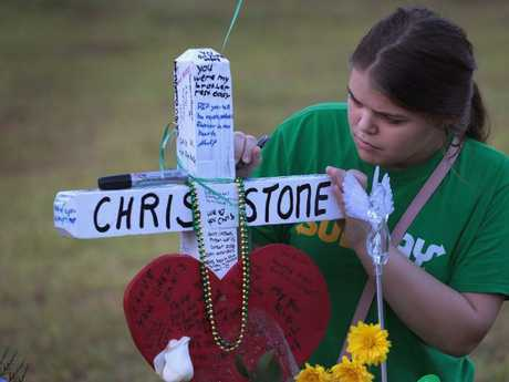 A mourners visited a memorial in front of Santa Fe High School on Monday. Picture: Scott Olson/Getty Images/AFP