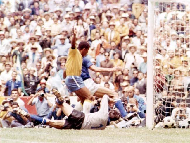 Ventura Filmo Jairzinho, (golden shirt), scores Brazil's third goal in the 1970 final against Italy.