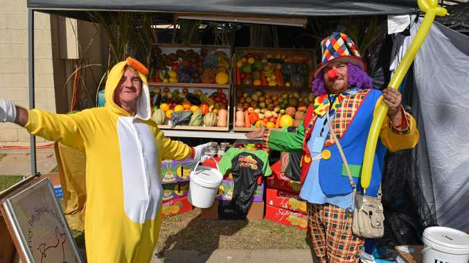 Offering fruit on Friday arvo for a small donation will be Hervey Bay Special School character men (left) Ian Dinte and newcomer and Ian's protege Jason Hooper.