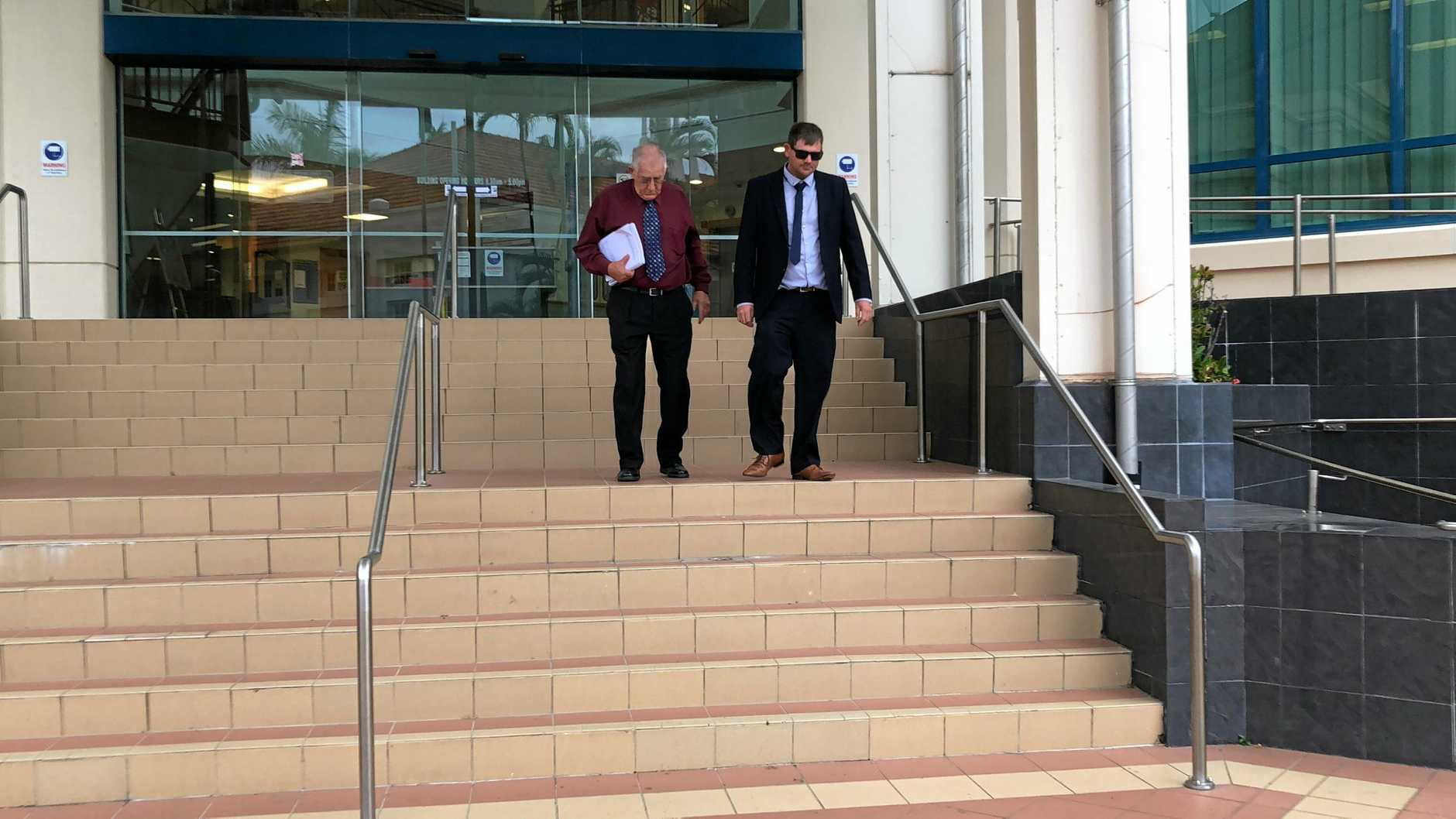 Former director of Leucaena Chop Pty Ltd David Alsop and the now director and his son Sam Alsop leaving Rockhampton Magistrates Court after Leucaena Chop was fined $104,000 for a workplace accident that changed a man's life catastrophically.