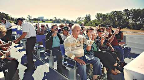 Cheers! Attendees have the option of travelling to the festival aboard the Hervey Bay Boat Club's Amaroo while enjoying a glass of sparkling wine.