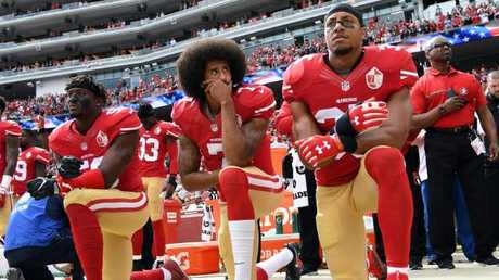 Eli Harold, Colin Kaepernick and Eric Reid of the San Francisco 49ers kneel on the sideline during a pre-game anthem in 2016. Picture: Thearon W Henderson/Getty
