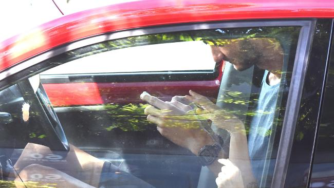 Drivers continue to prove unable to resist their mobiles behind the wheel. Picture: John Gass/AAP