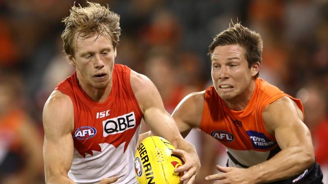 SYDNEY, AUSTRALIA - MARCH 09: Callum Mills of the Swans is tackled by Toby Greene of the Giants during the JLT Community Series AFL match between the Sydney Swans and the Greater Western Sydney Giants at Blacktown International Sportspark on March 9, 2018 in Sydney, Australia. (Photo by Cameron Spencer/Getty Images)