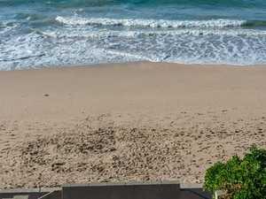 Body on beach: 'We're doing a headcount'