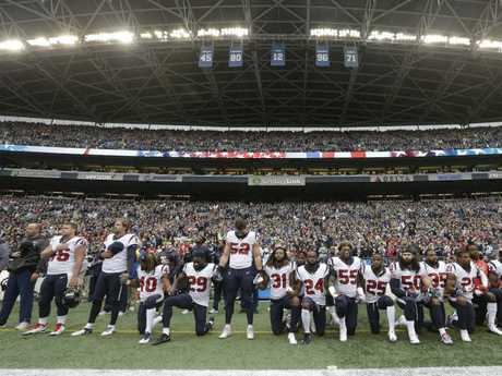Houston Texans players during the national anthem before an NFL game in Seattle. NFL owners have approved a new policy to address the firestorm. Picture: AP
