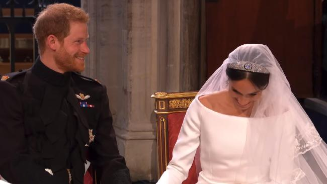 Harry and Meghan share a moment.