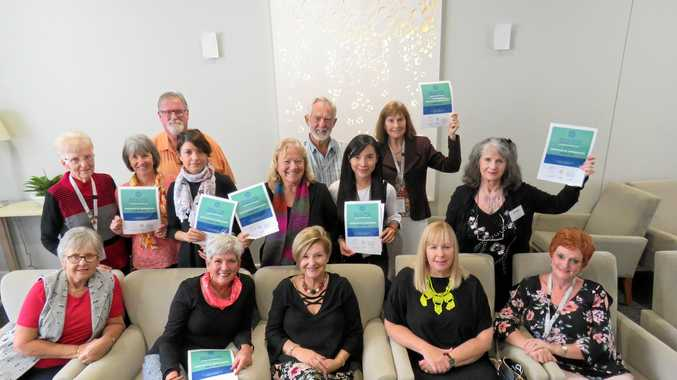 HERE'S TO YOU: Volunteers with their certificates of appreciation at a lunch from Arcare.
