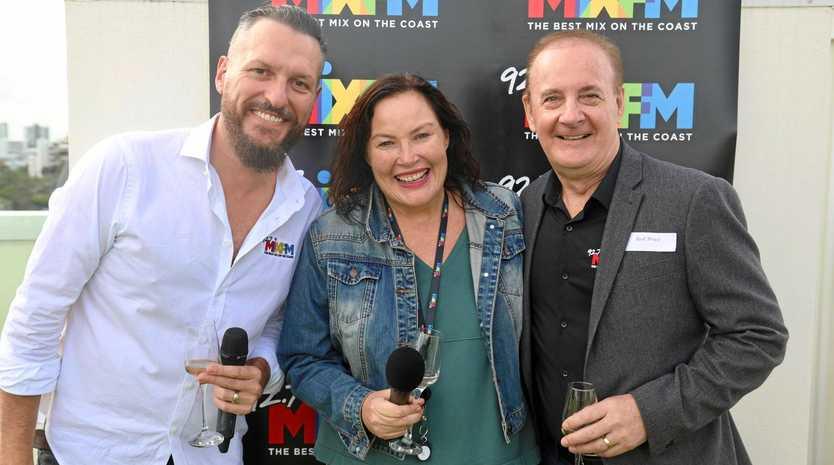 Co-host Mark Darin (left) and Mix-FM director of content Rod Brice (right) celebrate Caroline Hutchinson's 20th anniversary on Sunshine Coast radio.