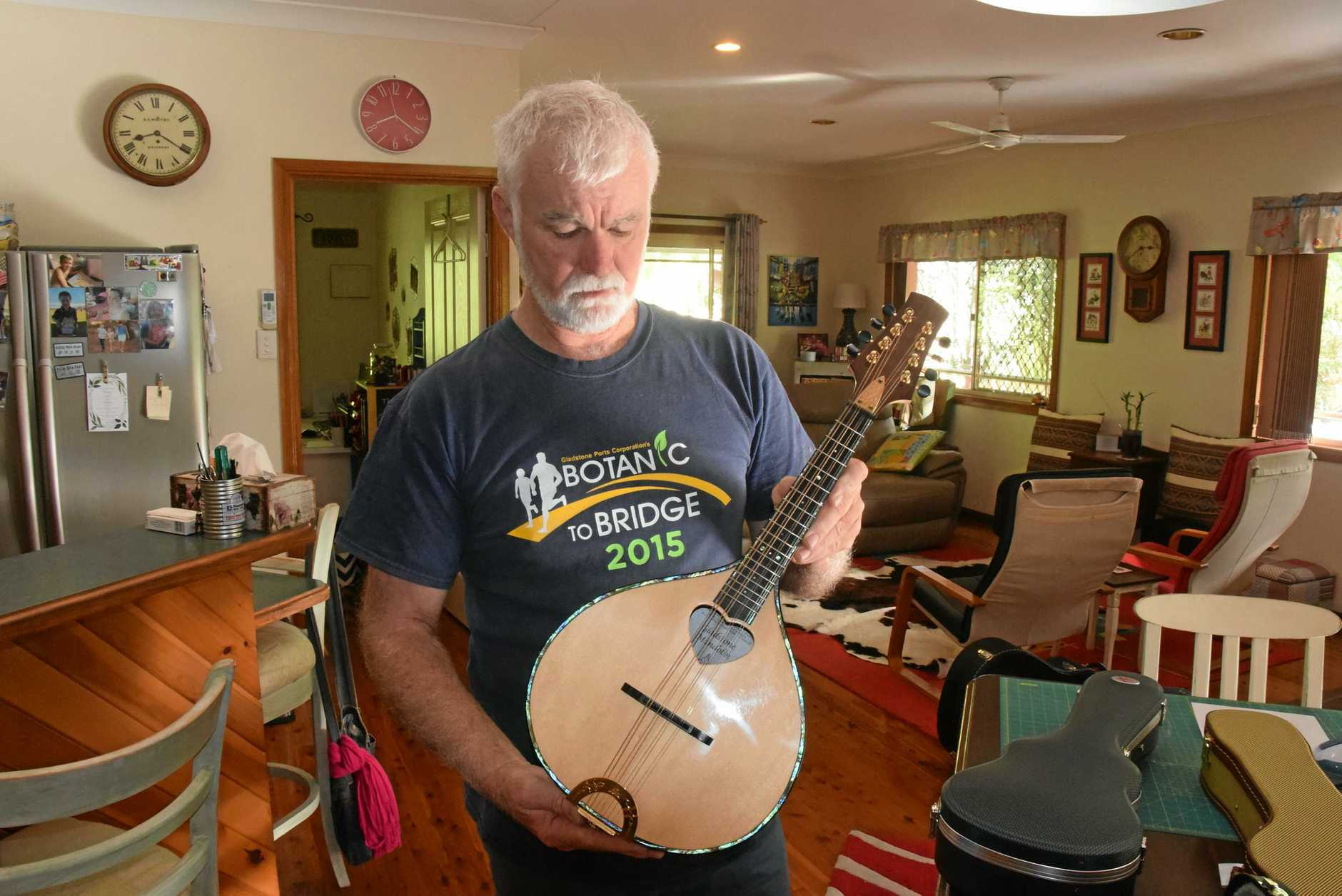 MUSIC MAKER: Graham Long holds one of the guitars he has made