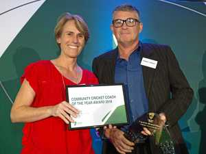 Coach collects community cricket award