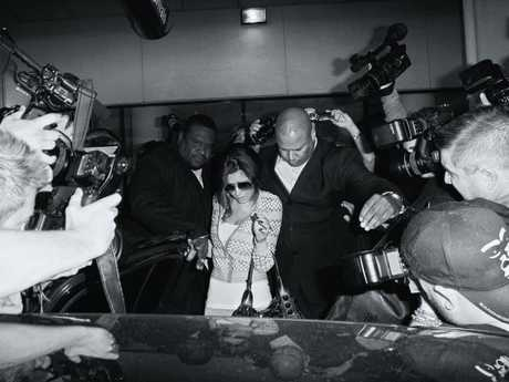 That's Cheryl Cole, battling through an army of photographers. Picture: Max Butterworth
