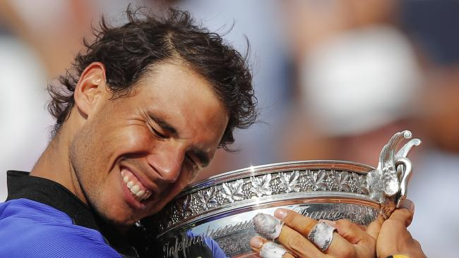 Rafael Nadal posts with the trophy after winning his tenth French Open last year.