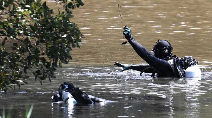 Police divers in the Pimpama River. Picture: Regi Varghese