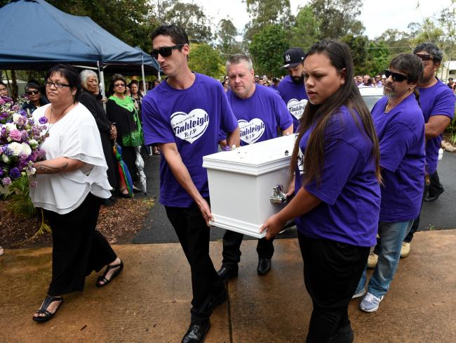 Pallbearers – including Rick Thorburn (centre) – carry the coffin of murdered schoolgirl Tiahleigh Palmer during her funeral in Cornubia, south of Brisbane, on November 14, 2015. Picture: AAP Image/Dan Peled