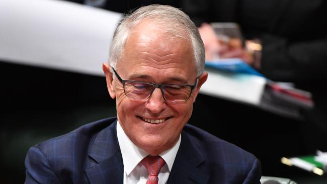 Is it a coincidence or is Prime Minister Malcolm Turnbull having a laugh ...? Picture: Mick Tsikas/AAP