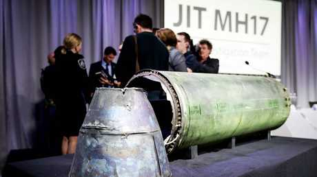 A part of the Buk-TEAR rocket fired on the MH17 flight is displayed on a table during the persconference of the Joint Investigation Team (JIT), in Bunnik on Thursday.