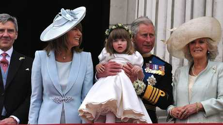 Prince Charles holds up Eliza, then 3. Picture: AFP Photo/WPA Pool/John Stillwell