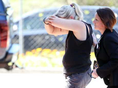 Julene Thorburn led into Logan Police Station for questioning over Tiahleigh's murder in her home. Picture: Jack Tran