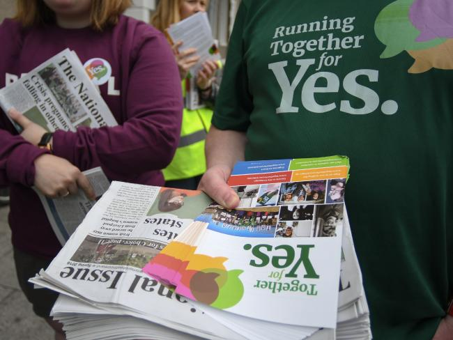 Activists from the Together For Yes campaign hold leaflets as they canvass for a 'Yes' vote in the referendum.