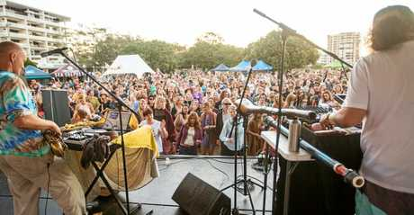 A crowd enjoys live music at the 2017 World Environment Day Festival at Cotton Tree.