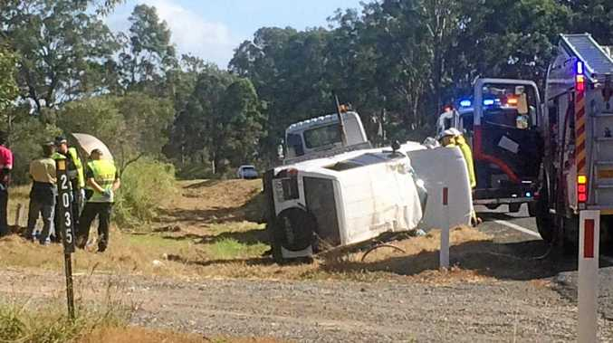 A white Prado has rolled on the Bruce Highway near Curra.