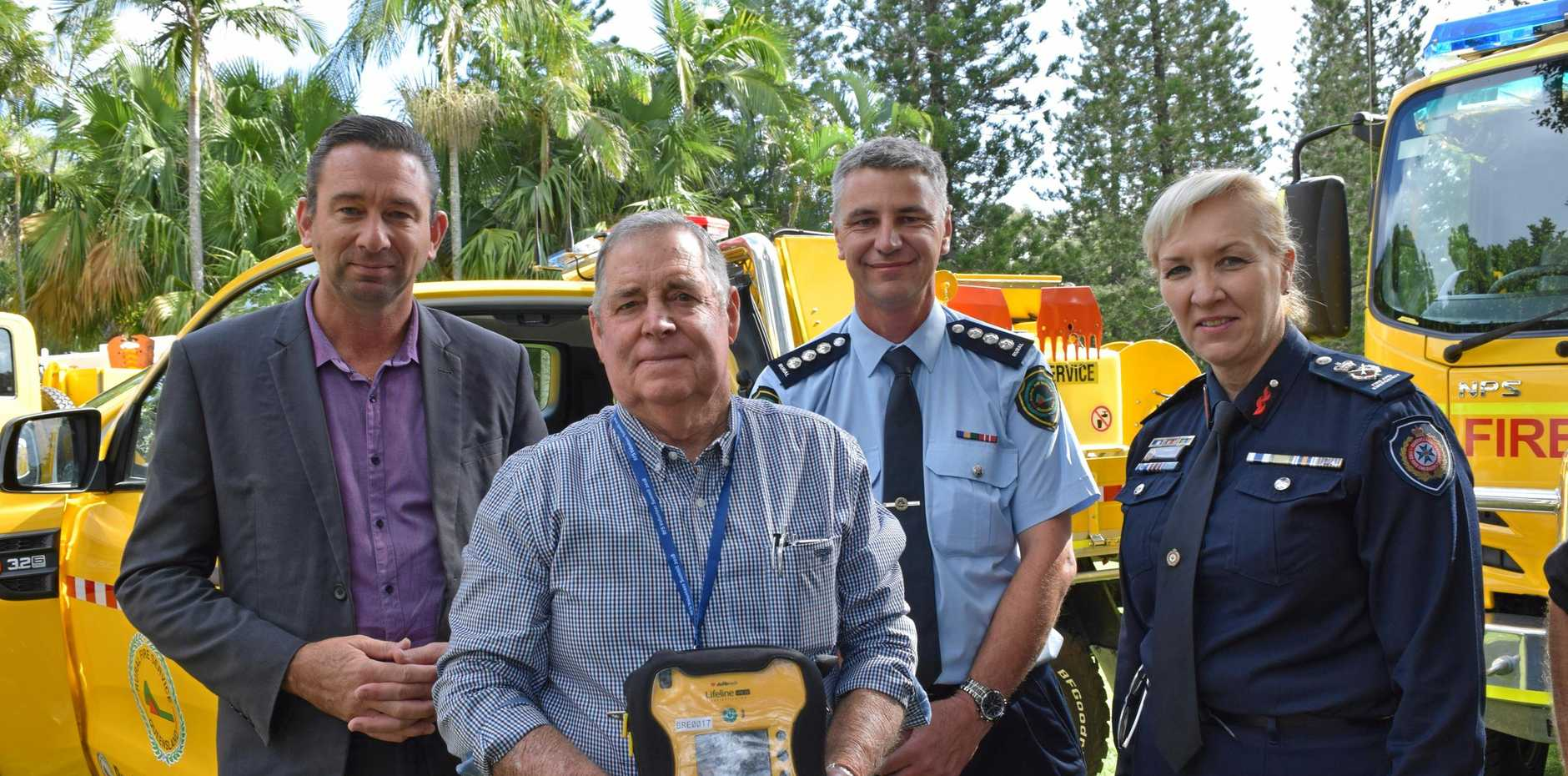 Minister Craig Crawford, Noosa volunteer firefighter Ian Pike, Inspector Mark Saunders and Katarina Carroll announce the installation of defibrillators in all rural fire service vehicles in Queensland.