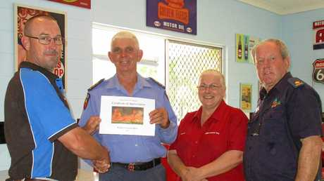 WIDGEE NEWS: Peter & Karen Alexander of Widgee General Store were presented with a Certificate of Appreciation for their continued support of Widgee Rural Fire Brigade by First Officer Barry Dyer (second from left) and Brigade Chairman Chris Lhotka (right).