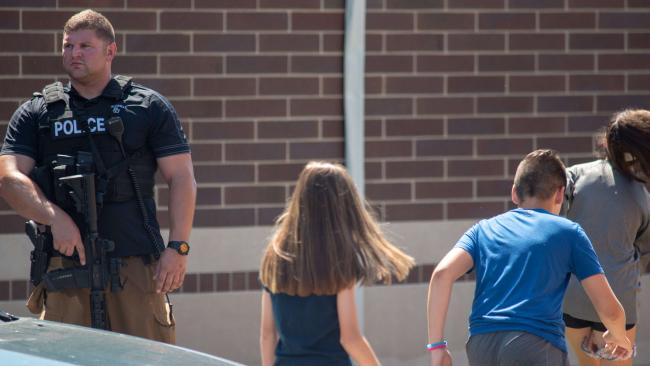 Kids flee Noblesville West Middle School after the shooting. Picture: Kevin Moloney
