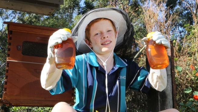 Finn Tolhurst is a 10-year-old Reedy Creek boy who's developed a business selling honey from the beehives in his backyard. Picture Glenn Hampson