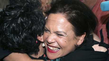 Sinn Fein leader Mary Lou McDonald reacts with a member of the