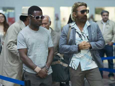 David Oyelowo (left) and Sharlto Copley in a scene from Gringo.