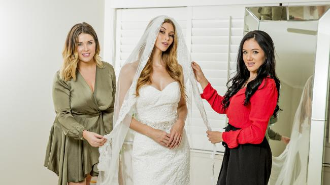 Rhianon Halfpenny and Ayla Schepisi from Luxe Bridal Hire have set up a wedding dress hire company on the Gold Coast. Giving women a chance to make some money on their dresses left hanging in a closet. Model Holly Bell trying on a dress. Picture: Jerad Williams