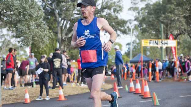 Matt Macdonald wins the 40 for Forte run around Prince Henry Drive. Sunday, 27th May, 2018.
