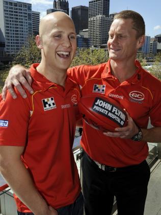 Ablett and Suns inaugural coach Guy McKenna after the champ announced his signing with Gold Coast.
