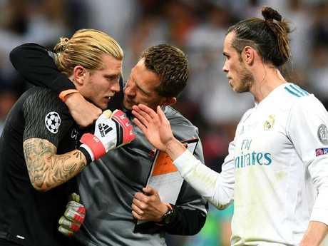 Gareth Bale (R) consoles Loris Karius after the Reds' keepers horror final.