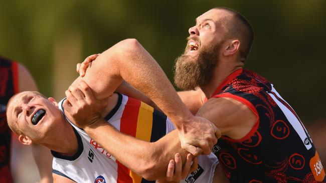 Melbourne ruckman Max Gawn pushes Adelaide's Sam Jacobs out of the way. Picture: Getty Images