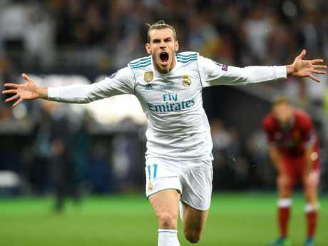 Gareth Bale celebrates scoring one of the greatest Champions League final goals.