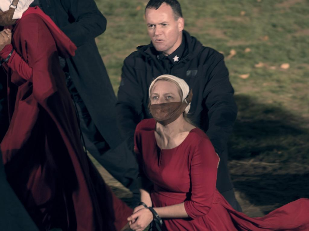 "Handmaids are punished for resisting authoritarian rule in the TV series, ""The Handmaid's Tale""."