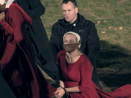 """Handmaids are punished for resisting authoritarian rule in the TV series, """"The Handmaid's Tale""""."""