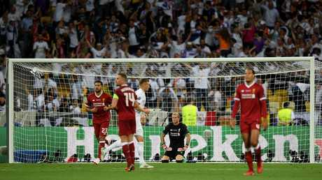 Loris Karius of Liverpool looks dejected after letting his sides third goal in