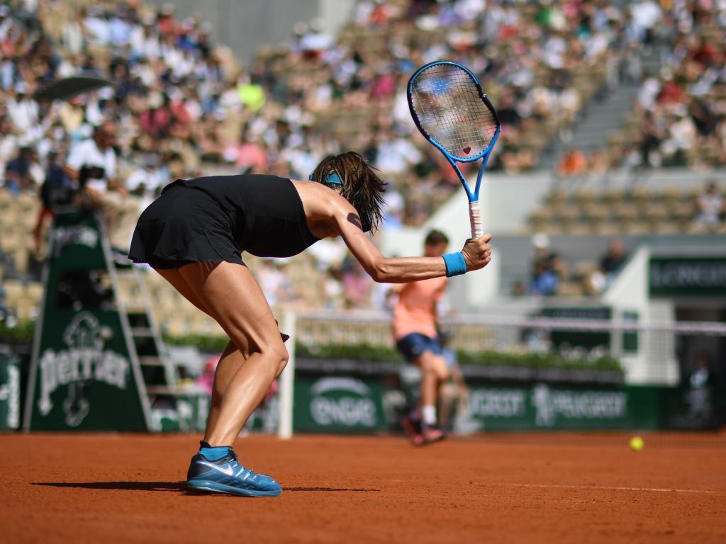 Australia's Ajla Tomljanovic smashes her racquet into the court.