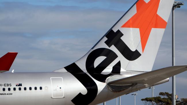 Woman escorted of Jetstar flight by Australian Federal Police.