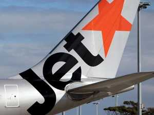 Woman hauled off Jetstar flight by feds